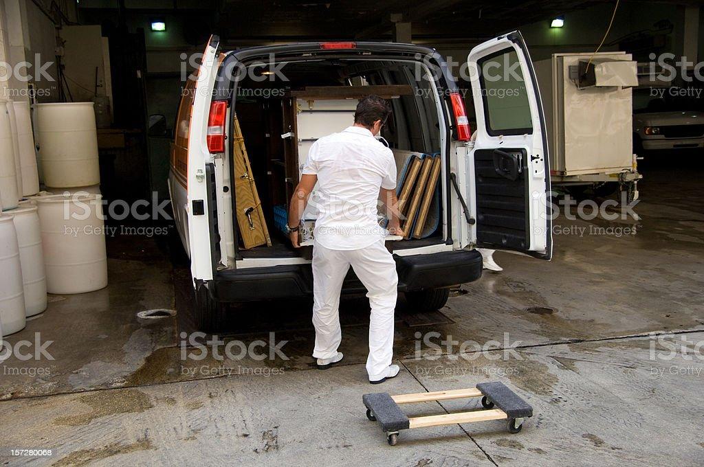 Unloading a van royalty-free stock photo