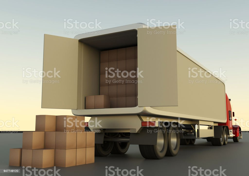 Unloading cardboard boxes from a truck. stock photo