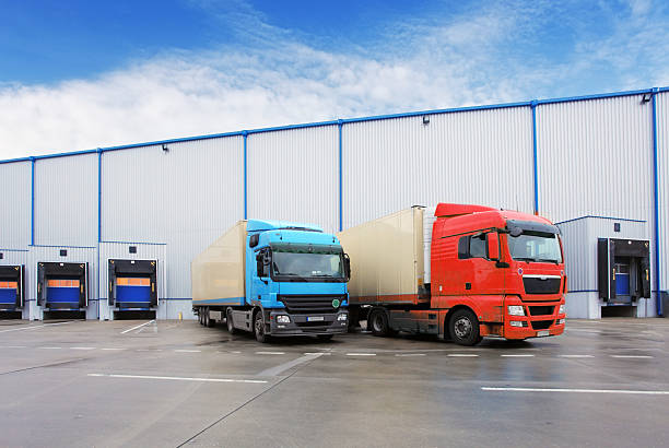 Unloading cargo truck at warehouse building Unloading cargo truck at warehouse building food warehouse stock pictures, royalty-free photos & images