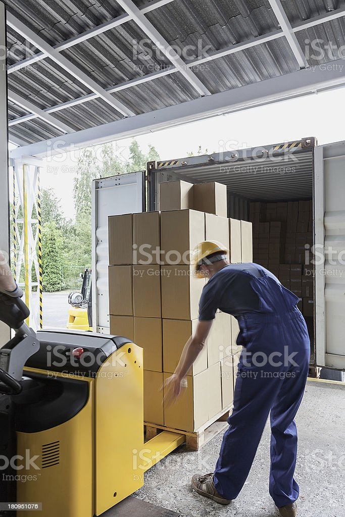 Unloading of articles stock photo