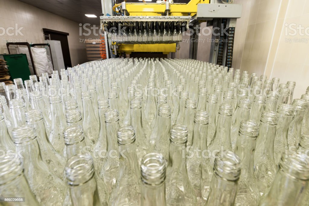 Unloading of glass bottles from pallets stock photo