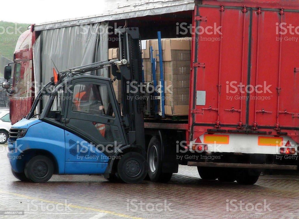 Unloading of truck full of cardboard stock photo