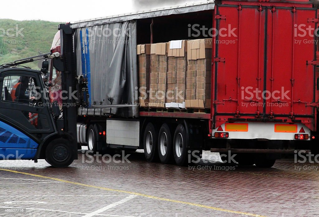 Unloading of truck stock photo