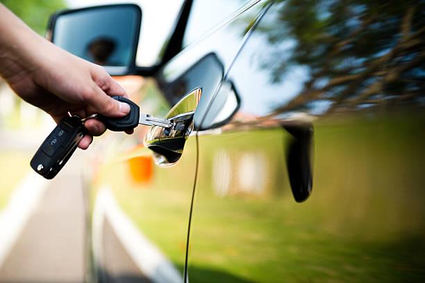 unlock car door Woman putting key in car door. car key stock pictures, royalty-free photos & images