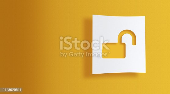 unlock sign on white square paper on yellow background with large copy space