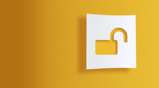 unlock sign on white information paper on yellow background stock photo