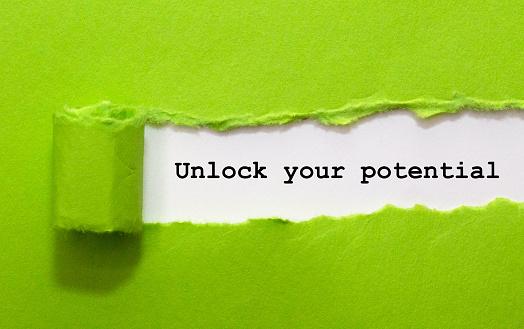 Unlock Your Potential Written Under Green Torn Paper