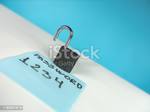488497362 istock photo Unlocked padlock on blue note with weak password 1162541619