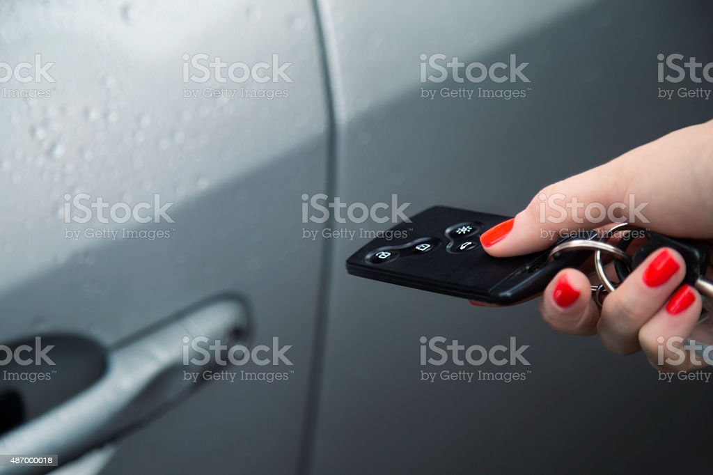 Unlocking car with car key remote control. stock photo