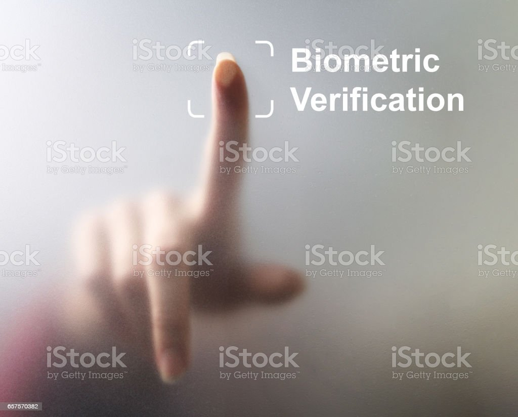 unlocking devices with fingerprint scan stock photo