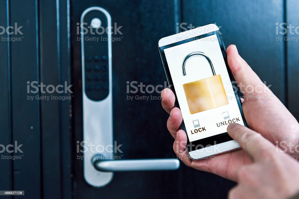Unlocking Front Door To House With App On Mobile Phone stock photo ...