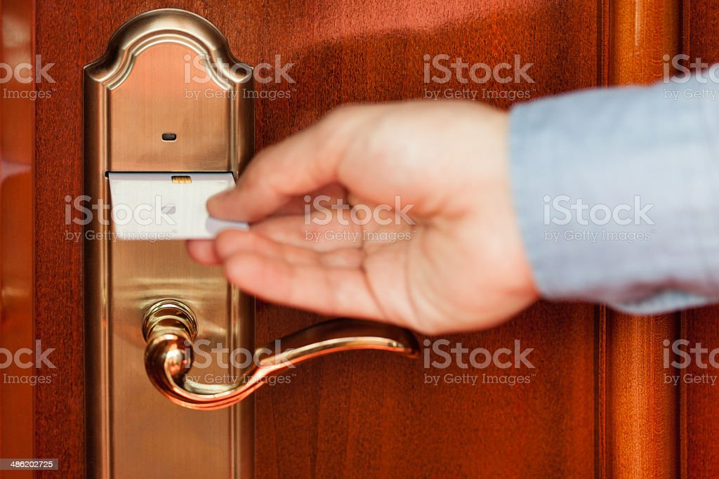 Unlocking hotel room with card key stock photo