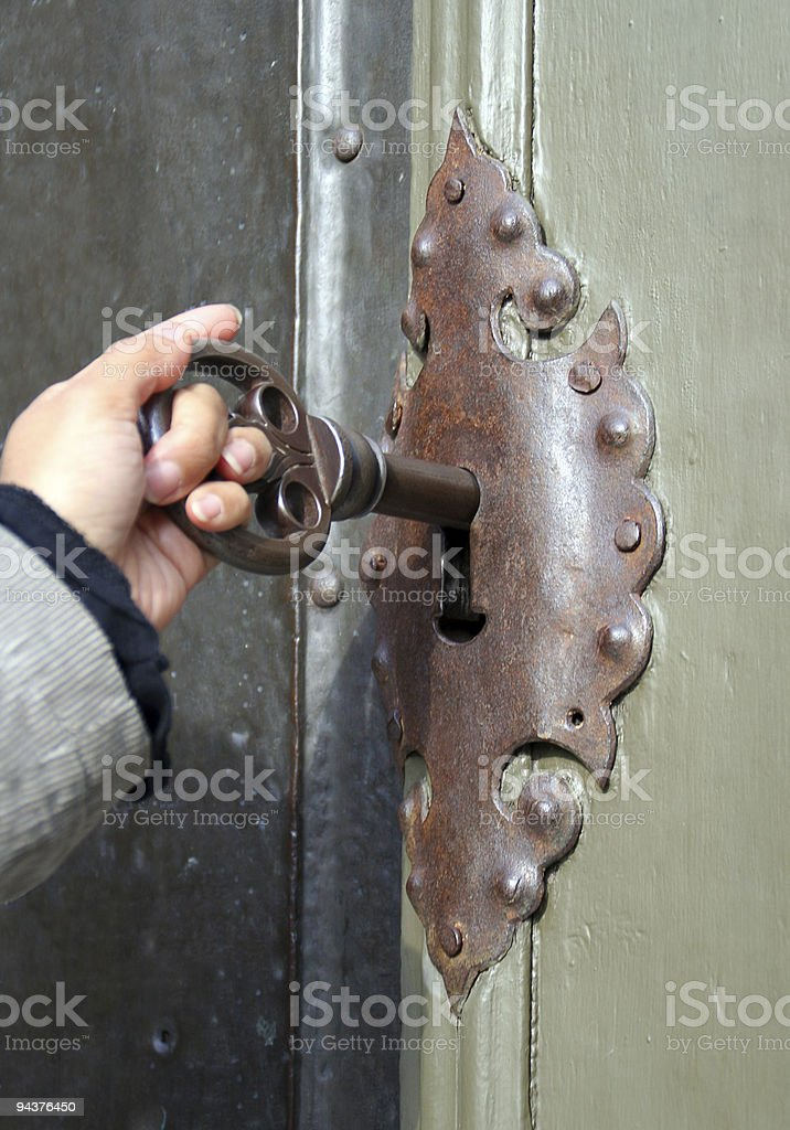 Unlocking the door royalty-free stock photo