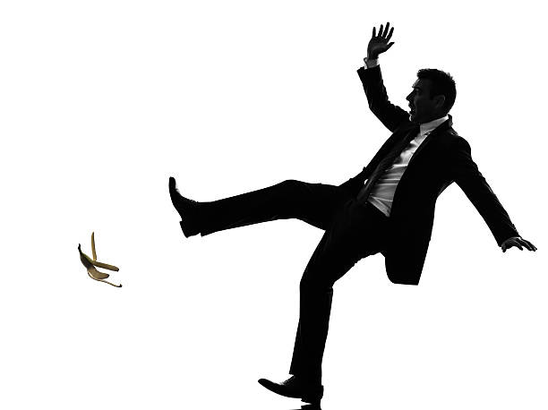 unlucky carefree business man silhouette one caucasian unlucky carefree business man in silhouette on white background banana peel stock pictures, royalty-free photos & images