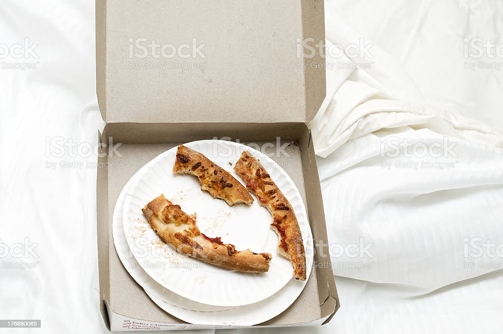 Unmade Bed and Pizza Crusts - Royalty-free Bed - Furniture Stock Photo