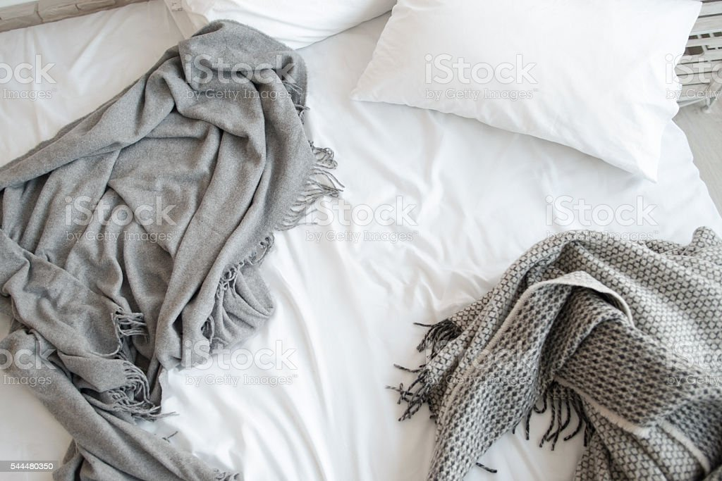 Unmade bed with pillow and gray blankets top view Bed Unmade Messy Bedroom Pillows White Copyspace Relax Morning Concept Backgrounds Stock Photo