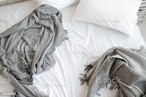 Unmade Bed With Pillow And Gray Blankets Top View Stock Photo - Download Image Now