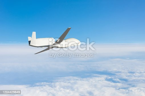 509897009 istock photo Unmanned military aircraft background blue sky above the cloudscape. Elements of this image furnished by NASA. 1204425649
