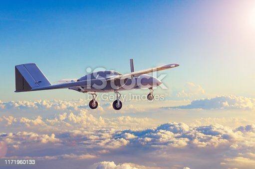 istock Unmanned military aircraft reconnaissance uav patrolling the evening at sunset sky clouds. 1171960133