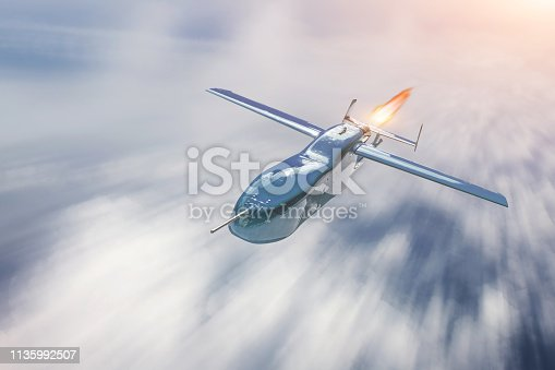 Unmanned military drone flying over cloudscape, motion blur speed