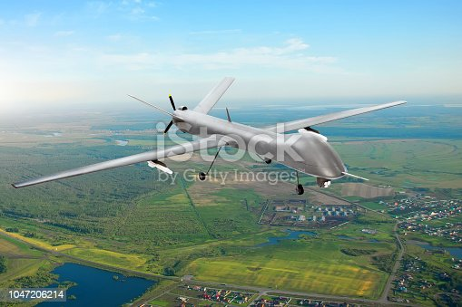 istock Unmanned military drone on patrol air territory at low altitude. 1047206214