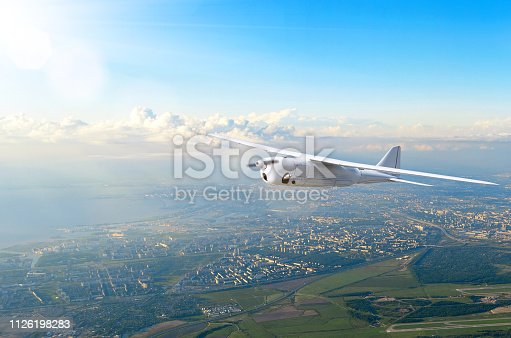 535194869 istock photo Unmanned military drone screw turboprop on patrol air territory at low altitude. 1126198283