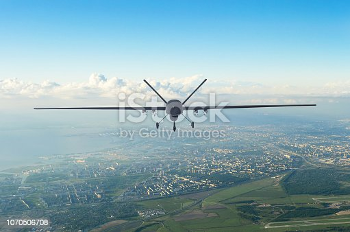 535194869 istock photo Unmanned military drone uav flying in the air over the city in the morning. 1070506708