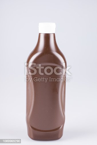 A unmarked bottle of barbeque sauce