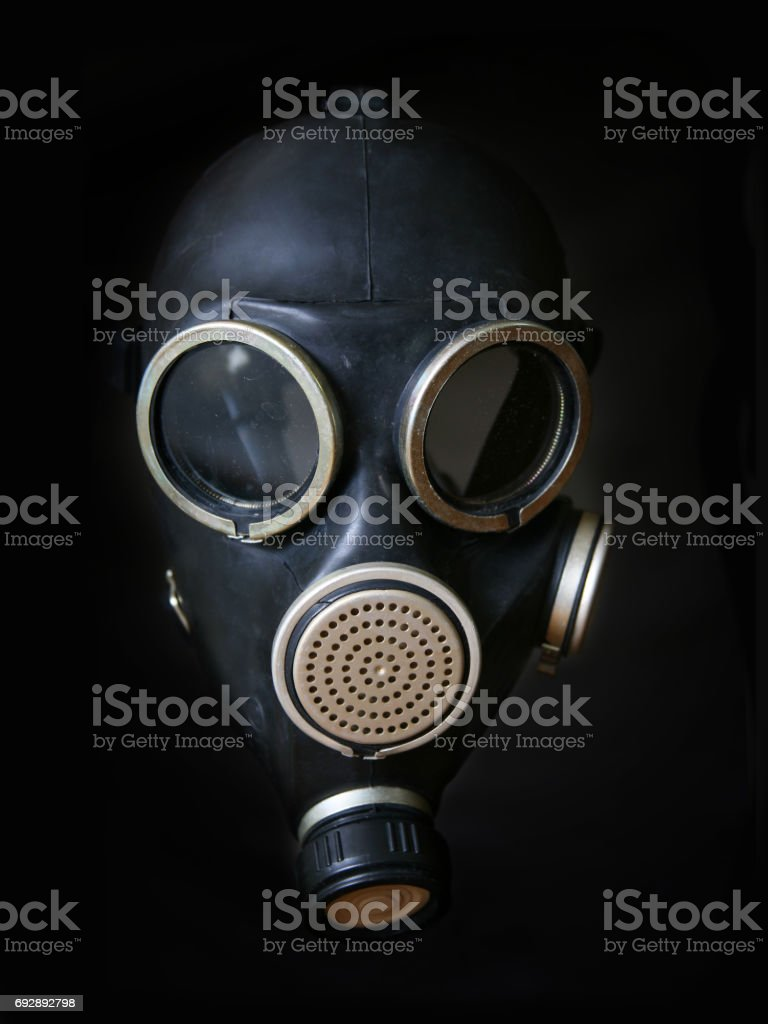 Unmodern gas mask on a black background stock photo