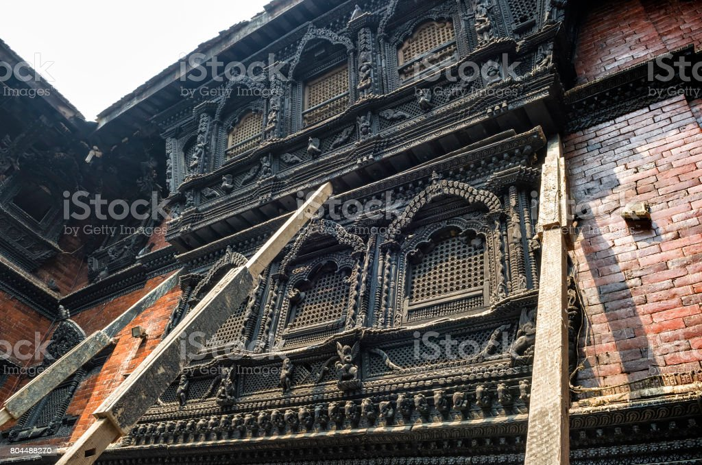 unning architecture in the Kumari Ghar temple of the living goddess Kumari Devi after major earthquake in 2015, Kathmandu, Nepal stock photo