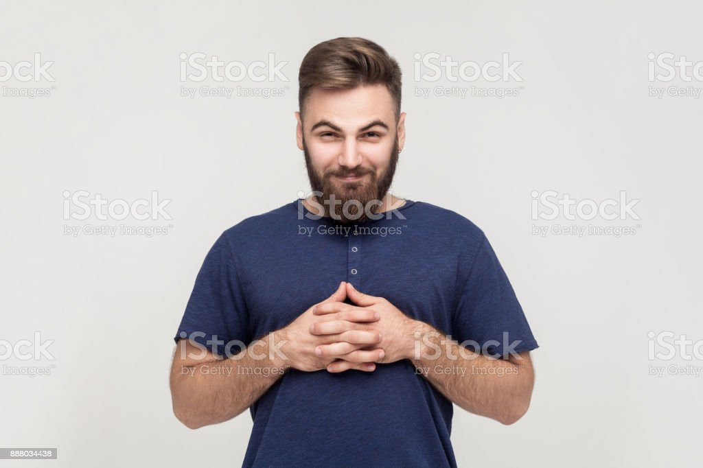 Ð¡unning businessman, crossed hands and looking slyly at camera. stock photo