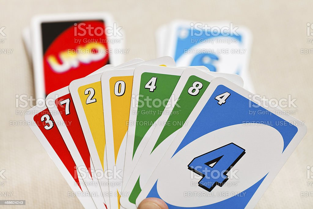 Uno game cards in player hand stock photo