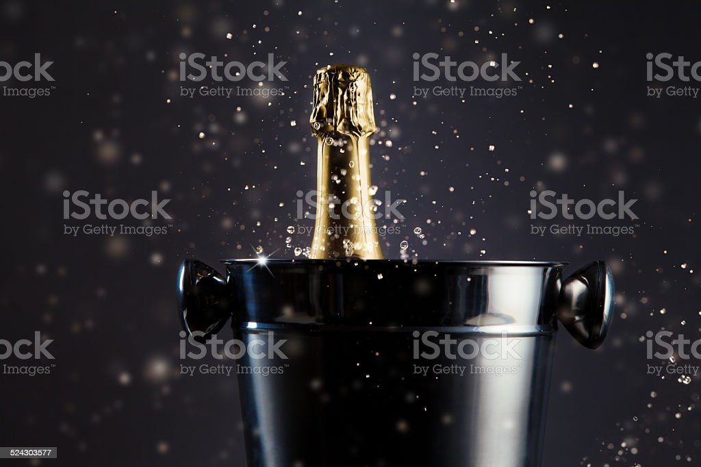 Unopened bottle of champagne in container stock photo