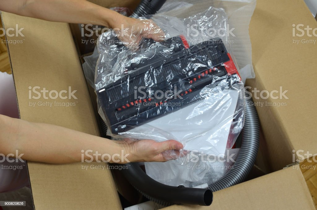 Unpacking a vacuum cleaner stock photo