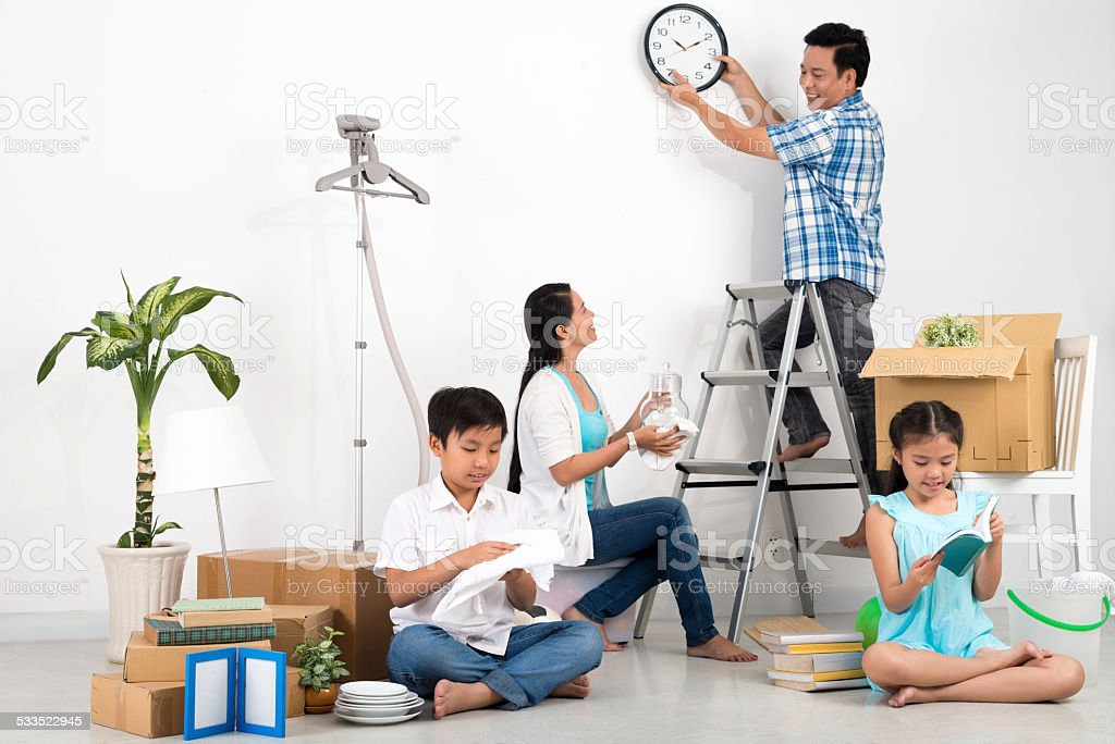 Unpacking family stock photo