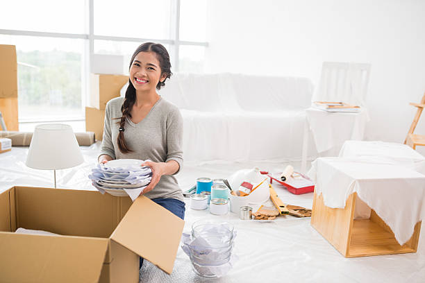 unpacking girl - fragility stock photos and pictures