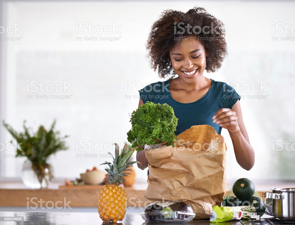 Unpacking her groceries stock photo