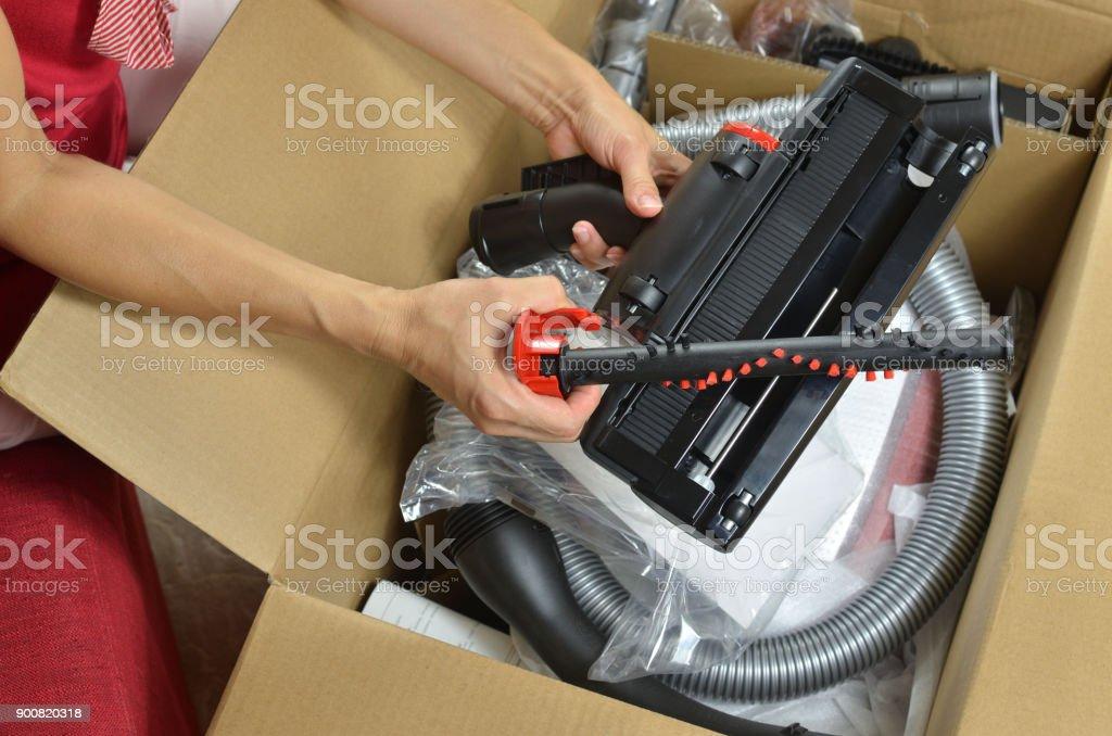 Unpacking modern vacuum cleaner stock photo