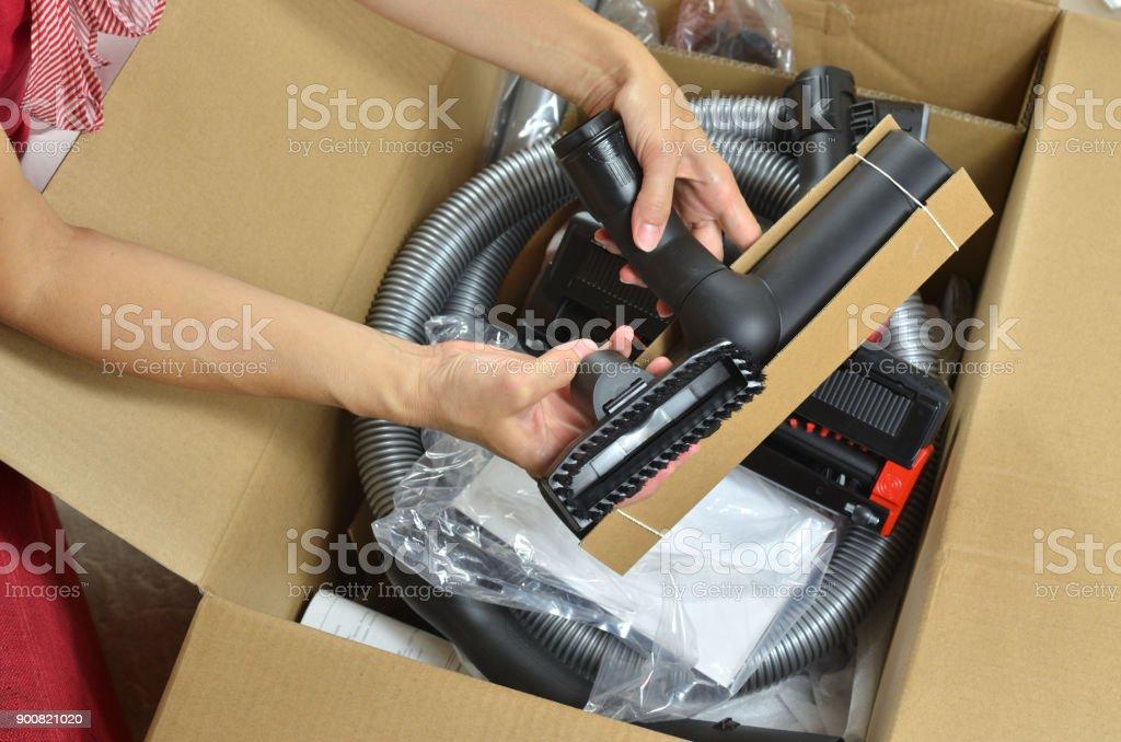 Unpacking new vacuum cleaner stock photo