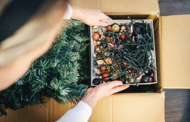 Unpacking the box of Christmas Tree stock photo