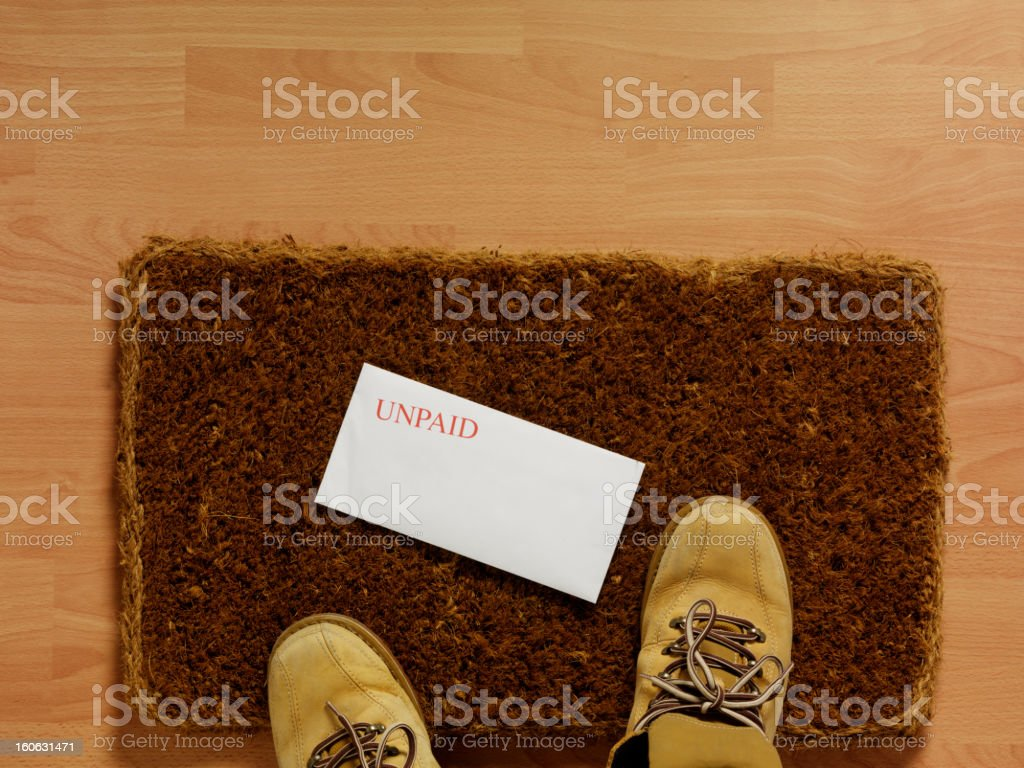 Unpaid Bill on the Doormat royalty-free stock photo
