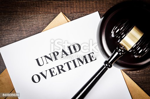 istock Unpaid Overtime title On Legal Documents 845835634