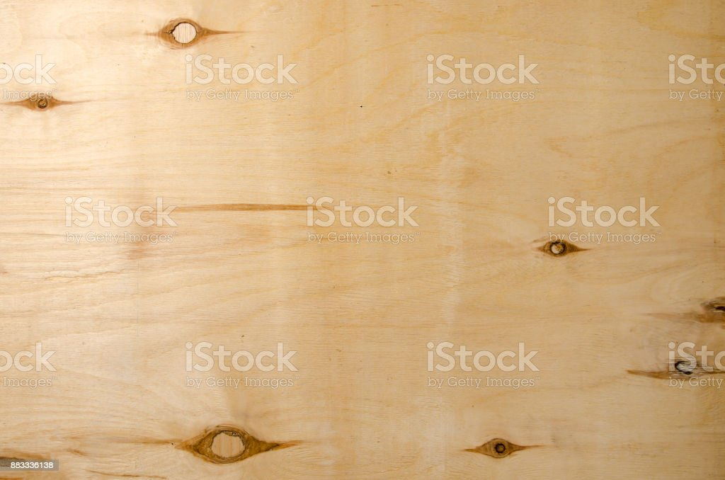unpainted sheet of plywood with knots as a background. stock photo
