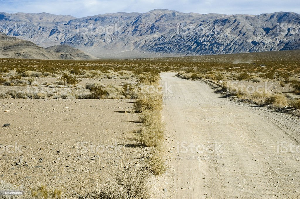 Unpaved desert road stock photo