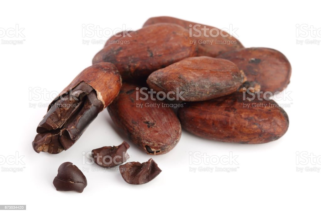 unpeeled cocoa bean isolated on white background macro top view stock photo