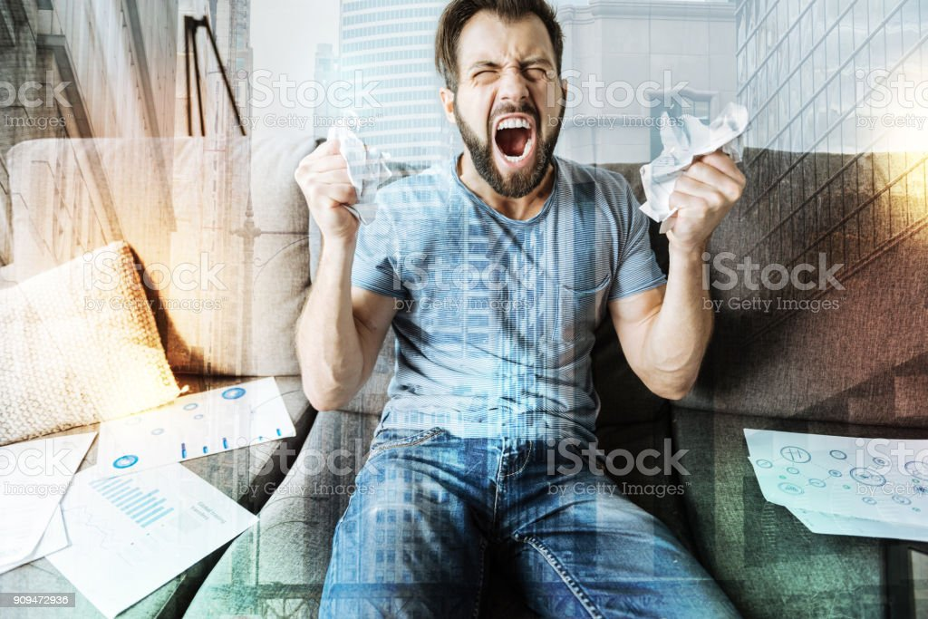 Unpleasant crapping man sitting and screaming stock photo