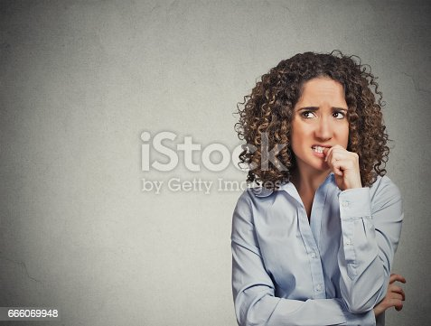 istock unpleased skeptical young curly brown hair woman 666069948