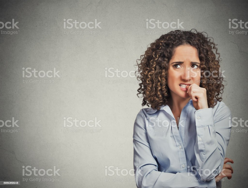 unpleased skeptical young curly brown hair woman stock photo