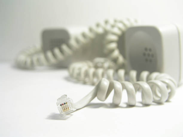 Unplugged Focus is on the phone jack. disjointed stock pictures, royalty-free photos & images