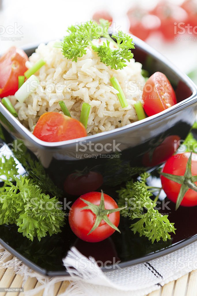 unpolished rice cooked with fresh tomatoes, healthy eating royalty-free stock photo